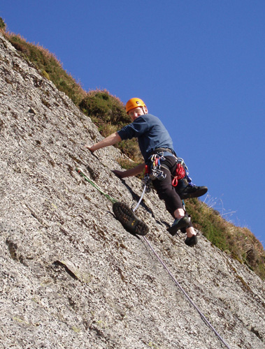 "Climbing on the ramp slabs, note the unusual runner - a ""draped"" sling weighted with a boot.."