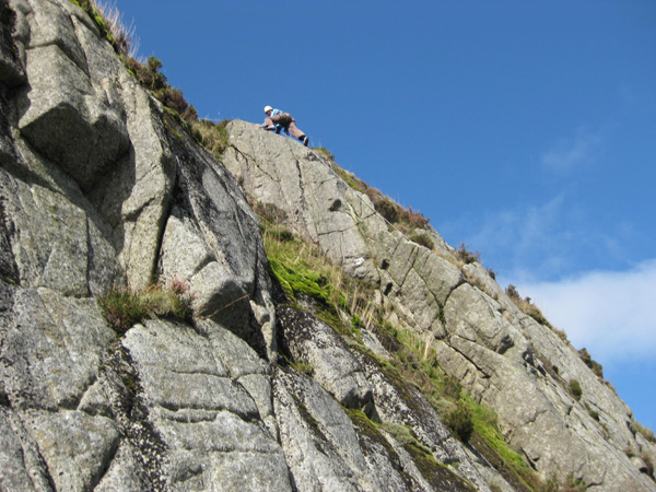 Linda Biggar topping out on the first ascent of The Sugar Loafers, Severe, Slab of the Spout, Cairnsmore of Fleet.