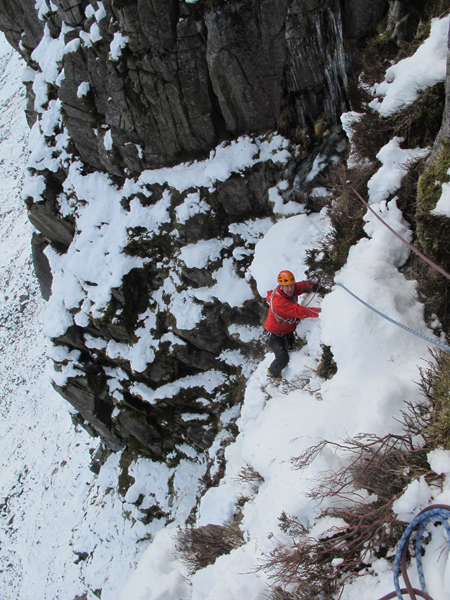 Myself on the third pitch traverse on the first winter ascent of Cooran Gully, III/IV, Dungeon of Buchan, February 2012.