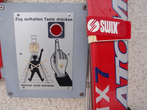 even when you are not skiing you are not safe - Swiss Railways sign seen at Madulain station.
